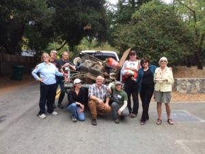 A few of the volunteers posing afterward with a truck full of trash removed from San Geronimo Creek.